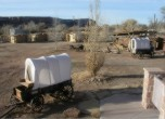 Bluff Fort -- Bluff Fort wagons, cabin replicas in the distance. Lamont Crabtree Photo